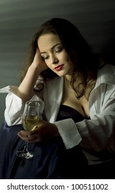 Glamour style portrait of pretty woman with glass of champagne