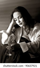 Glamour style portrait of pretty woman with glass of champagne. Black&White