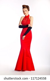 Glamour. Wedding style. Elegant beautiful bride - modern bridal red dress and black gloves