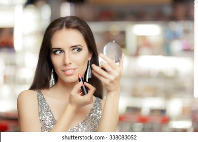 Glamour Woman with Lipstick and Make-up mirror - Cool girl holding a mirror and getting ready for a party
