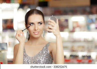 Glamour Woman with Mascara and Make-up mirror - Cool girl holding a mirror and getting ready for a party