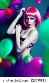 glamour woman in pink wig with balloons