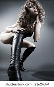 glamour woman posing against dark background