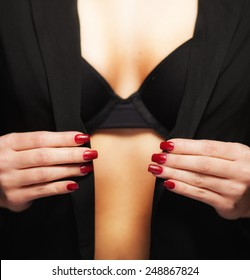 Glamour woman in unbuttoned jacket with red nails
