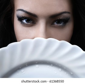 glamour woman with a white porcelain plate in hands
