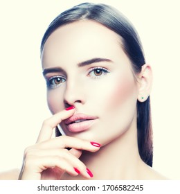 Glamour young woman beauty face, lips and perfect fresh skin, nail manicure, hand near mouth. Skincare Concept
