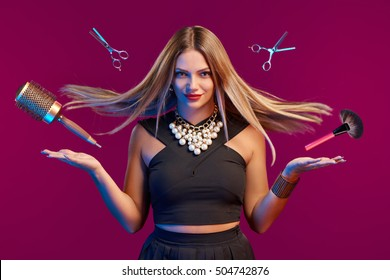 Glamourous female stylist with fluttering hair and flying hairdresser's accessories