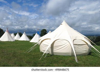 Glamping camping site with yurt and tepees at a British summer music festival. Glamorous camp sites like this have become increasingly popular around the United Kingdom.
