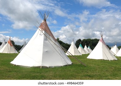 Glamping camping in tepees at festival. Glamorous camp sites like this have become increasingly popular at festivals around the United Kingdom.