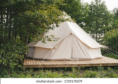 Glamping houses, boho way of living, rural landscape, tent houses