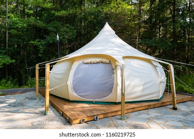 A glamping tent surrounded by forest in Ontario, Canada.