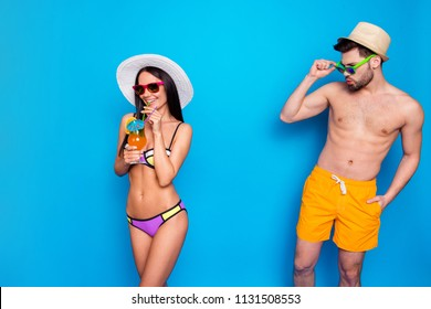 Glance over the glasses. Tanned man looks at the dark haired cute girl in a colorful bikini whistling. Hot summer, beach season