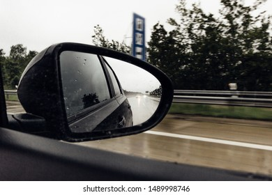 A glance in the rear-view mirror on a motorway journey