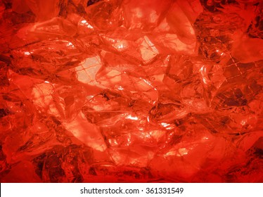 Glare glisten flame coquelicot rose color sulphate birthstone stack, mysterious lit by vivid hot carnelian coral glow. Close-up view with space for text on romantic refraction sparkle particle heap