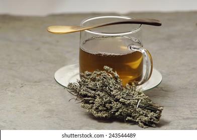 Glas of herbal tea with mugwort
