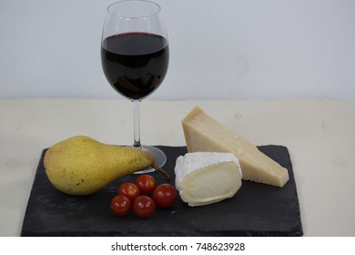 a glas red wine, with cheese