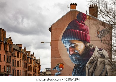 GLASGOW APRIL 02, 2016; Mural painting of a man with birds, on wall in central Galsgow, Scotland.