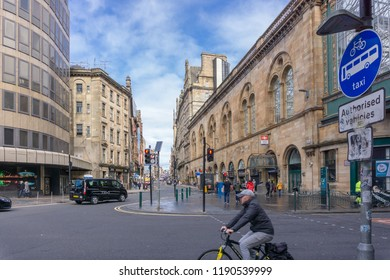Glasgow City, Scotland, UK - September 22, 2018: Looking up Hope Street Glasgow at the side of Central Station with pedestrians and traffic.
