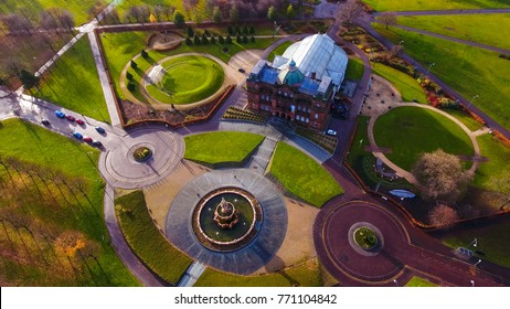 Glasgow Green, Glasgow, Scotland, UK; December 3rd 2017:  Aerial image of People's Palace, Winter Gardens  and Doulton Fountain at Glasgow Green lit by a low winter's sun.