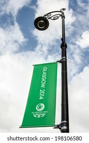 GLASGOW - JUNE, 2014:  Glasgow 2014 Commonwealth Games green flag on a strret lamp. Glasgow will be proud host of 2014 Commonwealth Games from 23 July - 3 August 2014.