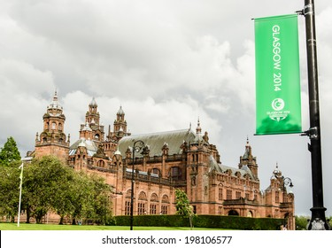 GLASGOW - JUNE, 2014:  The Kelvingrove museum with a green Glasgow 2014 flag. It refers to the Glasgow Commonwealth Games which will be hosted in the city from 23 July -?? 3 August 2014.