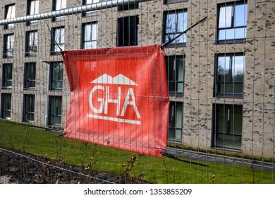 Glasgow, Scotland - 03 24 2019: Glasgow Housing Association Banner next to a new built houses