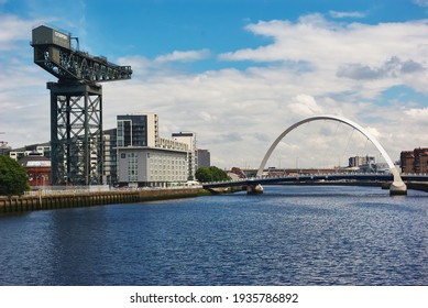 Glasgow, Scotland - 07 11 2009: river, crane, modern arch bridge