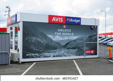 GLASGOW, SCOTLAND -11 JUL 2017- View of the car rental area with signs for car rental companies like Avis and Budget at the Glasgow Airport (GLA), the second busiest airport in Scotland.