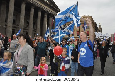Glasgow, Scotland, 14 September 2014 - pro-independence march and rally George Square to Pacific quay - passing the gallery of modern art and the statue of Wellington with cones on its head.