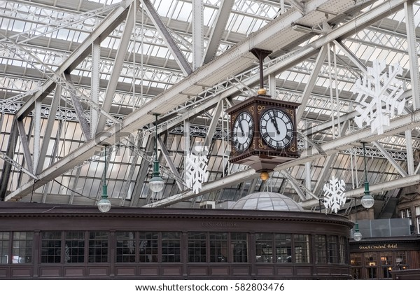 Glasgow, Scotland - 28 December 2016 : Meeting Point of Glasgow Central Train Station, the famous vintage clock, with Christmas Decorations.