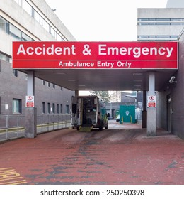 GLASGOW, SCOTLAND - 3 FEBRUARY 2015: Glasgow General Royal Infirmary A&E entrance with open ambulance parked outside
