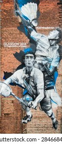 GLASGOW, SCOTLAND -  4 JUNE, 2015: Street Art Graffiti by unknown artist. Two athletes playing badminton during 2014 Commonwealth Games