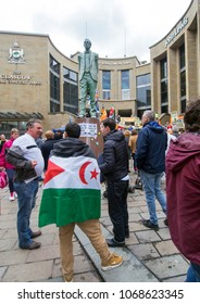 GLASGOW, SCOTLAND -APRIL 14TH 2018: A man wears the Sahrawi Arab Democratic Republic flag at a pro-Catalan demonstration at Buchanan street steps.