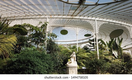 Glasgow, Scotland; August 17th 2019: The interior of the great glass conservatory of Kibble Palace at the Botanic Gardens.