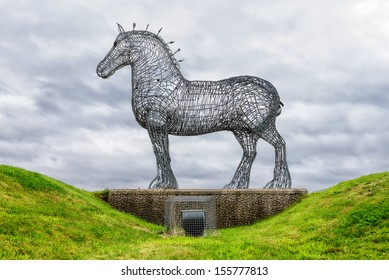 """GLASGOW, SCOTLAND - AUGUST 28: """"The Heavy Horse"""" by Andy Scott is a sculpture of a Clydesdale Horse and one of the best known artworks in Scotland, on August 28th, 2013 in Glasgow, Scotland, UK"""
