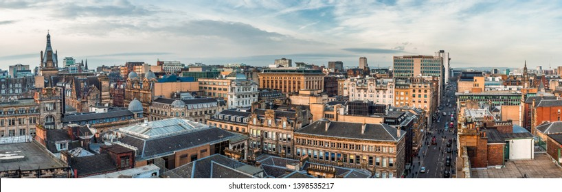 Glasgow / Scotland - February 15, 2019: A wide panoramic looking out over old and new buildings and streets in Glasgow city centre. Scotland, United Kingdom