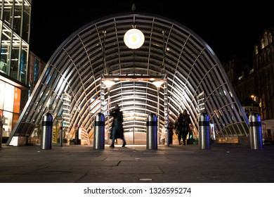 Glasgow, Scotland / Great Britain - February 22, 2019: Exterior Night Shot of Illuminated entrance to St Enoch Subway station on Argyll Street