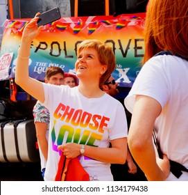 Glasgow, Scotland - July 15th 2018: Nicola Sturgeon takes a selfie with Choose Love tshirt