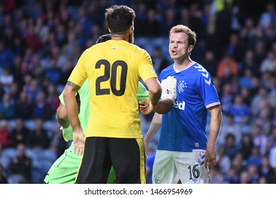 GLASGOW, SCOTLAND - JULY 18, 2019: Federico Martin Villar and Andy Halliday argue during the 2019/20 UEFA Europa League First Qualifying Round game between  Rangers FC and St Joseph's.