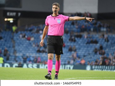 GLASGOW, SCOTLAND - JULY 18, 2019: Austrian FIFA referee Christopher Jaeger awards a penalty kick during the 2019/20 UEFA Europa League First Qualifying Round game between Rangers and St Joseph's.