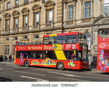 GLASGOW, SCOTLAND - JULY 20: City sightseeing tour bus in George's Square on July 20, 2017 in Glasgow, Scotland. Tour buses are a popular way for travellers to visit the city of Glasgow.