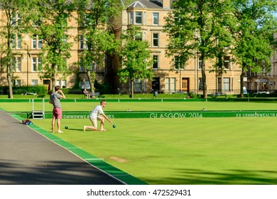 GLASGOW, SCOTLAND - JULY 21, 2016: Two men playing barefoot bowls at the Kelvin Grove Bowling and Tennis Centre in summer.