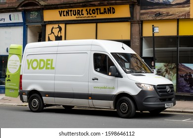 GLASGOW, SCOTLAND - JULY 31, 2019: Mercedes-Benz Sprinter white van of the Yodel transportation company which is delivering goods to Scottish shops and stores