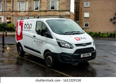 GLASGOW, SCOTLAND - JULY 31, 2019: White Ford Transit Custom light commercial van of the BBP (Bell Building Projects) company.