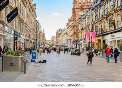 GLASGOW, SCOTLAND - JUNE 03, 2015: Buchanan Street is a gracious pedestrian area lined with excellent architecture and some of the city's finest shopping with lots of designer brands represented.