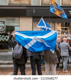 GLASGOW, SCOTLAND; JUNE 15th 2018. People wearing the saltire around them. This is a protest against Westminster power grab against Scottish devolution.