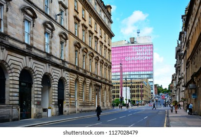 """Glasgow / Scotland - June 20, 2018: street in Glasgow with the """"People Make Glasgow"""" city brand on the building"""