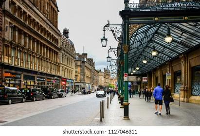 Glasgow / Scotland - June 20, 2018: view of the Gordon Street in Glasgow, Scotland, with the entrance to Glasgow Central station and Glasgow Central Hotel