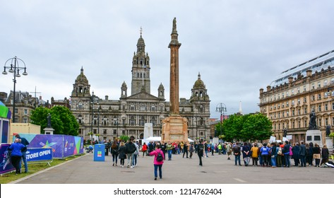 Glasgow / Scotland — June 20, 2018: view of George Square in Glasgow with the Glasgow City Chambers, headquarters of Glasgow City Council