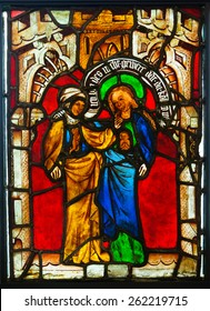 GLASGOW, SCOTLAND - MARCH  19, 2015: Stained glass panel made  in Germany in the late 14th Century, depicting The Visitation, exhibited in The Burrell Collection
